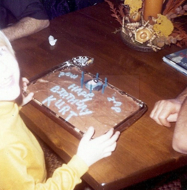 Description of . This undated photo provided by Kim Cobain a young Kurt Cobain celebrates a birthday at his childhood home in Aberdeen, Wash.   (AP Photo/Courtesy Kim Cobain)
