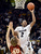 University of Colorado's Xavier Johnson takes a shot over John Gage, No. 40, during a game against Stanford on Thursday, Jan. 24, at the Coors Event Center on the CU campus in Boulder. Jeremy Papasso/ Camera