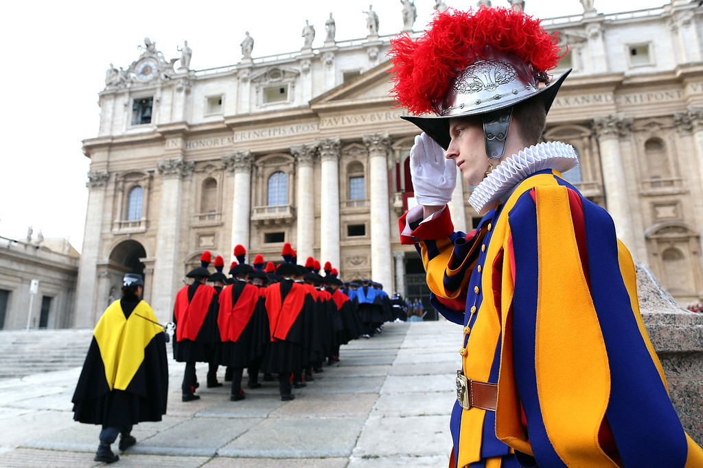Description of . VATICAN CITY, VATICAN - DECEMBER 25:  Carabinieri, Italian special police, and Swiss Guards arrive in St. Peter's Square to attend Pope Francis' Christmas Day message from the central balcony of St Peter's Basilica on December 25, 2013 in Vatican City, Vatican. The 'Urbi et Orbi' blessing (to the city and to the world) is recognised as a Christmas tradition by Catholics with the Pope Francis focusing this year on the peace in the world.  (Photo by Franco Origlia/Getty Images)