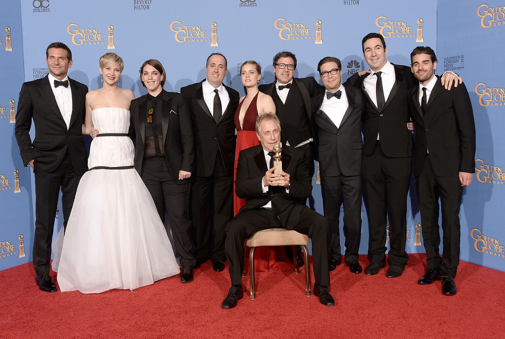 Description of . Cast and producers of \'American Hustle,\' winners of Best Motion Picture - Musical or Comedy for \'American Hustle,\' pose in the press room during the 71st Annual Golden Globe Awards held at The Beverly Hilton Hotel on January 12, 2014 in Beverly Hills, California.  (Photo by Kevin Winter/Getty Images)