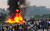 In this Sept. 28, 2012 file photo, Nepalese gather around the burning wreckage at the crash site of a Sita Air airplane near Katmandu, Nepal. The plane carrying trekkers to the Everest region crashed and burned just after takeoff in NepalÃs capital, killing the 19 Nepali, British and Chinese people on board. (AP Photo/File)
