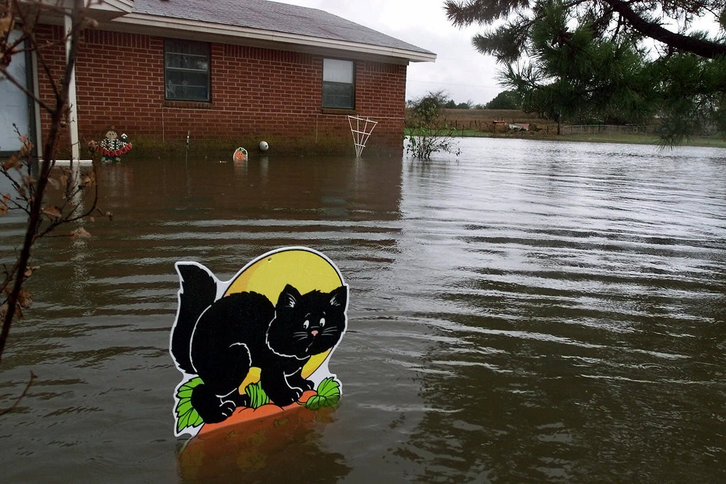 Description of . A Halloween decoration stands in the flooded front yard in the Southern Hills Addition near Anadarko, Okla. Wednesday, Oct. 25, 2000. (AP Photo/J. Pat Carter)