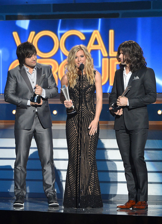 Description of . LAS VEGAS, NV - APRIL 06:  (L-R) Musicians Neil Perry, Kimberly Perry and Reid Perry of The Band Perry accept the Vocal Group of the Year award onstage during the 49th Annual Academy Of Country Music Awards at the MGM Grand Garden Arena on April 6, 2014 in Las Vegas, Nevada.  (Photo by Ethan Miller/Getty Images)