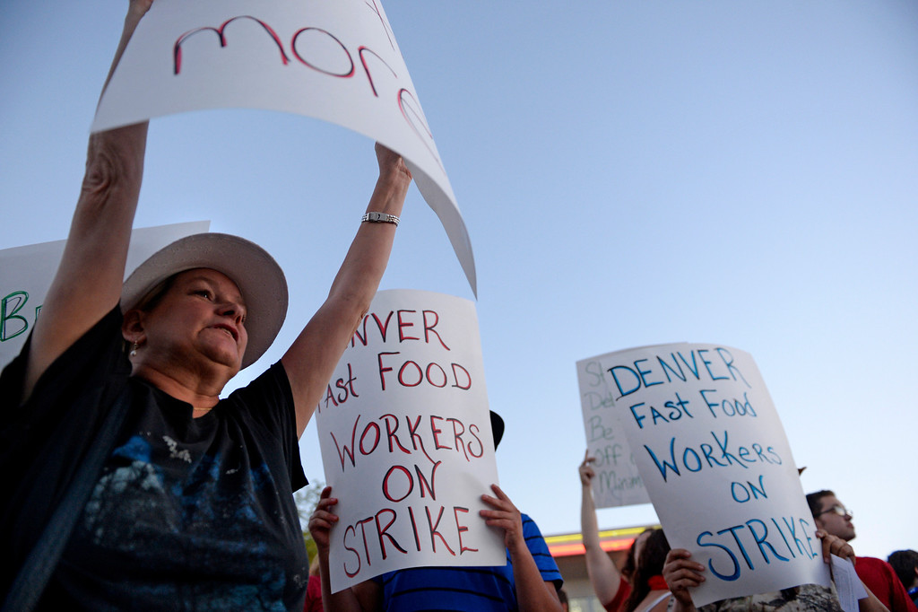 Description of . NORTHGLENN, CO-August, 2013: Mary Glenn, left, joined other protesters asking for better wages for fast food workers stand outside a McDonald's in Northglenn, August 29, 2013. The asking rate is $15 an hour for workers in this nationally organized event. (Photo By RJ Sangosti/The Denver Post)