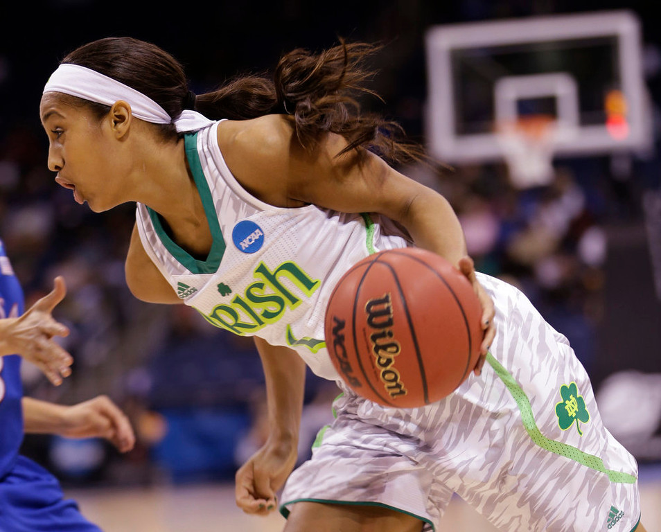 Description of . Notre Dame guard Skylar Diggins (4) drives to the basket  during the second half of a regional semi-final of an NCAA college basketball tournament  Sunday, March 31, 2013 in Norfolk, Va.  Notre Dame won the game 93-63. (AP Photo/Steve Helber)