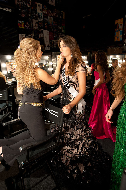 Description of . Miss Venezuela 2012, Irene SofÌa Esser Quintero, gets her makeup done by a MAC artist backstage during the 2012 Miss Universe Presentation Show on Thursday, Dec. 13, 2012 at PH Live in Las Vegas. The 89 Miss Universe Contestants will compete for the Diamond Nexus Crown on December 19.  (AP Photo/Miss Universe Organization L.P., LLLP)