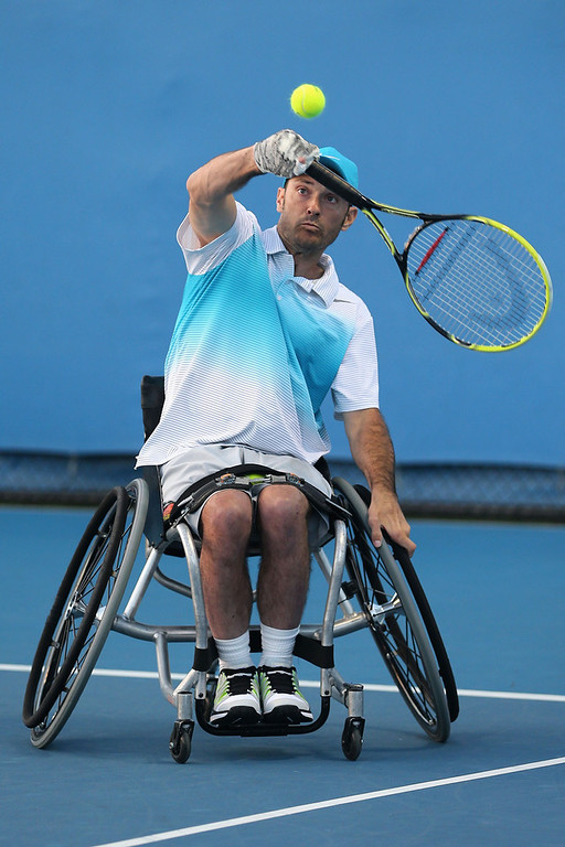 Description of . David Wagner of the United States of America plays a backhand in his Quad Wheelchair Doubles Final match with Nicholas Taylor of the United States of America against Anders Hard of Sweden and Andrew Lapthorne of Great Britain during the 2013 Australian Open Wheelchair Championships at Melbourne Park on January 25, 2013 in Melbourne, Australia.  (Photo by Scott Barbour/Getty Images)