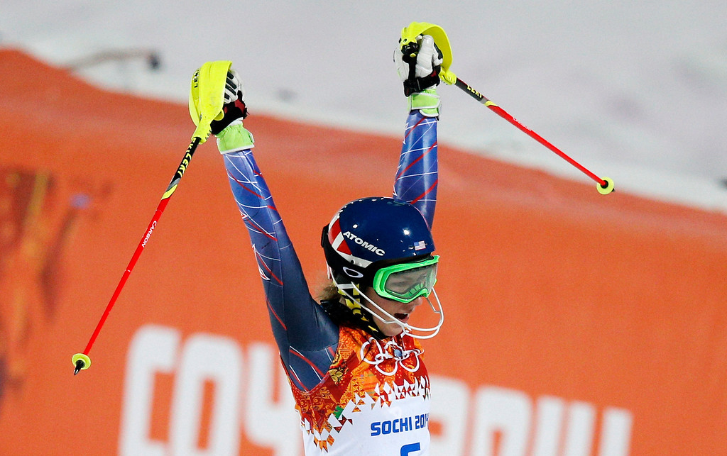 Description of . Gold medal winner Mikaela Shiffrin of the United States celebrates as she finishes the second run of the women's slalom at the Sochi 2014 Winter Olympics, Friday, Feb. 21, 2014, in Krasnaya Polyana, Russia.(AP Photo/Christophe Ena)
