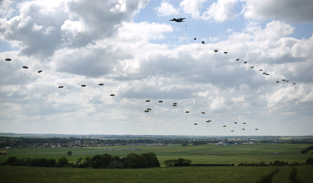 Description of . A parachute drop takes place on June 5, 2014 near Ranville, France.   (Photo by Peter Macdiarmid/Getty Images)