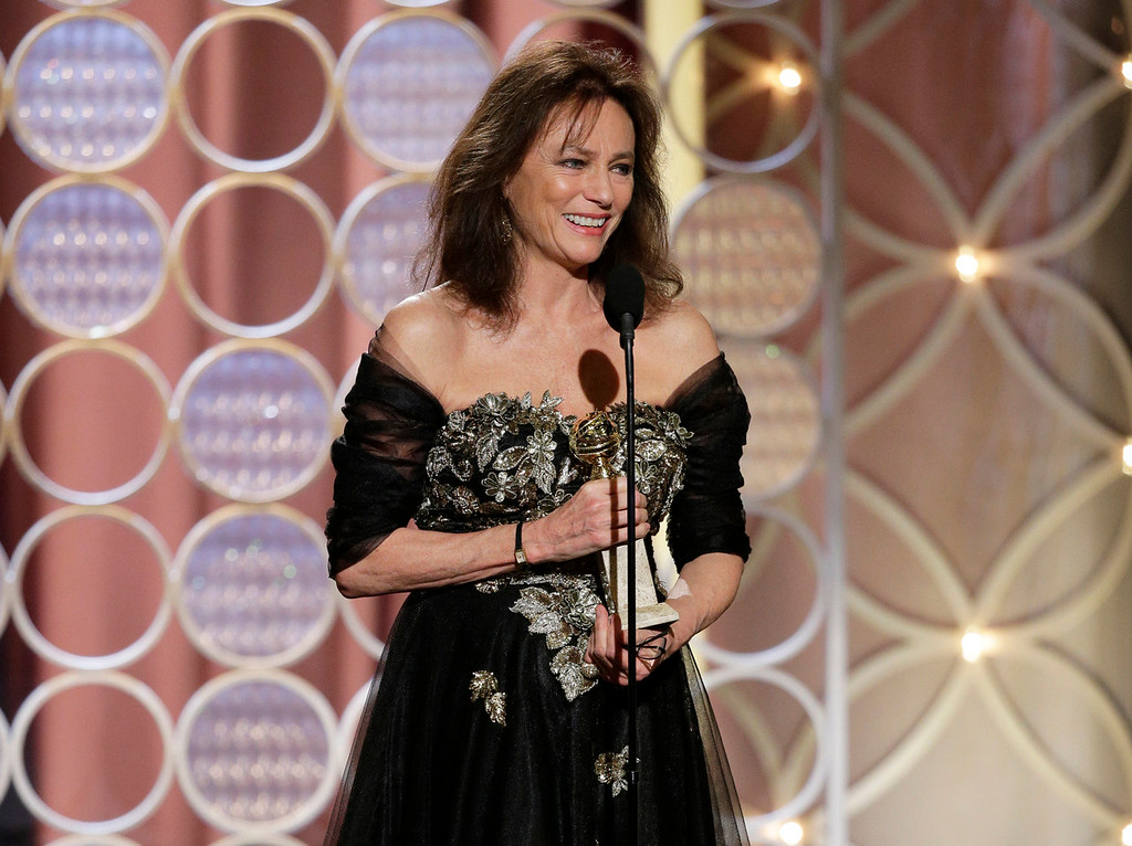 "Description of . This image released by NBC shows Jacqueline Bissett accepting the award for best supporting actress in a series, mini-series or TV movie for her role in, ""Dancing on the Edge\"" during the 71st annual Golden Globe Awards at the Beverly Hilton Hotel on Sunday, Jan. 12, 2014, in Beverly Hills, Calif. (AP Photo/NBC, Paul Drinkwater)"