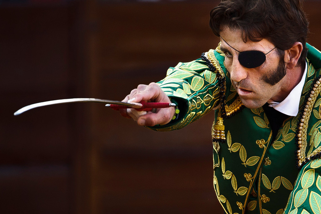 Description of . In this March 4, 2012 file photo, Spanish bullfighter Juan Jose Padilla aims his sword before killing a bull during a bullfight in the southwestern Spanish town of Olivenza. This photo is one in a series of images by Associated Press photographer Daniel Ochoa de Olza that won the second place prize for the Observed Portrait series category in the World Press Photo 2013 photo contest.  (AP Photo/Daniel Ochoa de Olza, File)