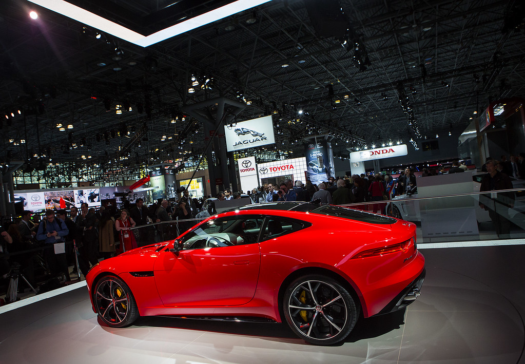 Description of . A Jaguar F Type sports car is seen during a media preview of the 2014 New York International Auto Show April 16, 2014 in New York City. The show opens with a sneak preview to the public April 18 and runs through April 27.  (Photo by Eric Thayer/Getty Images)