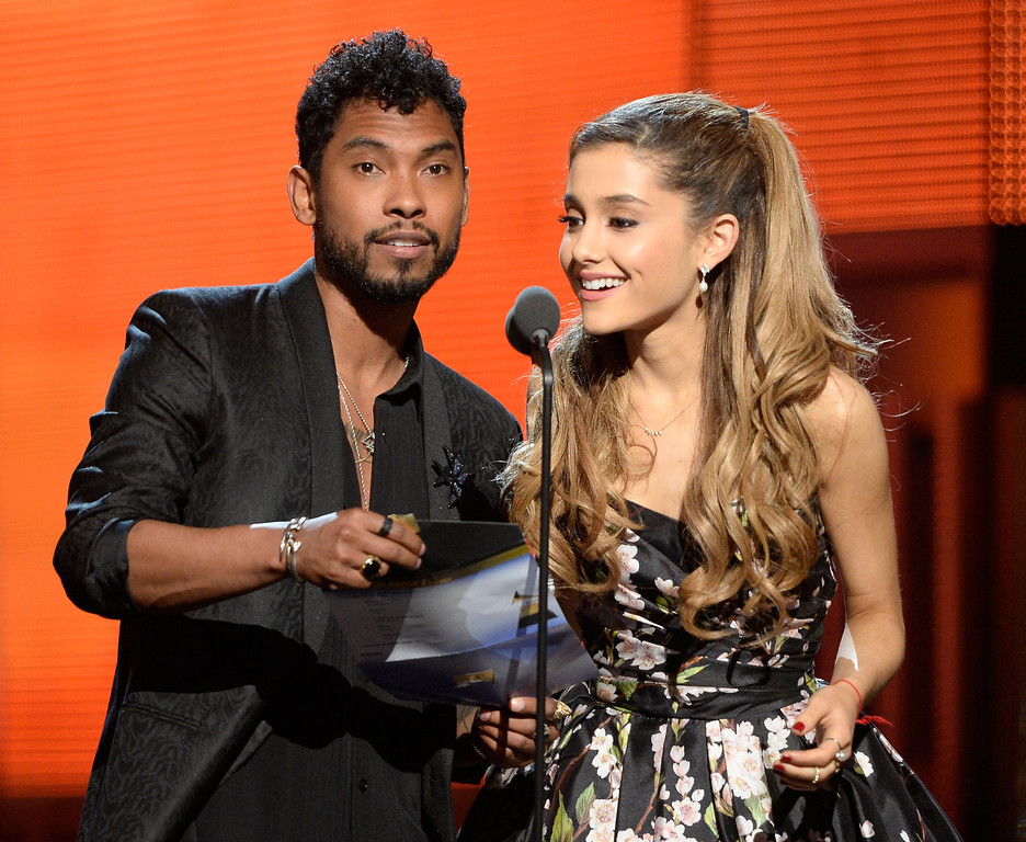 Description of . Singers Miguel (L) and Ariana Grande speak onstage during the 56th GRAMMY Awards at Staples Center on January 26, 2014 in Los Angeles, California.  (Photo by Kevork Djansezian/Getty Images)