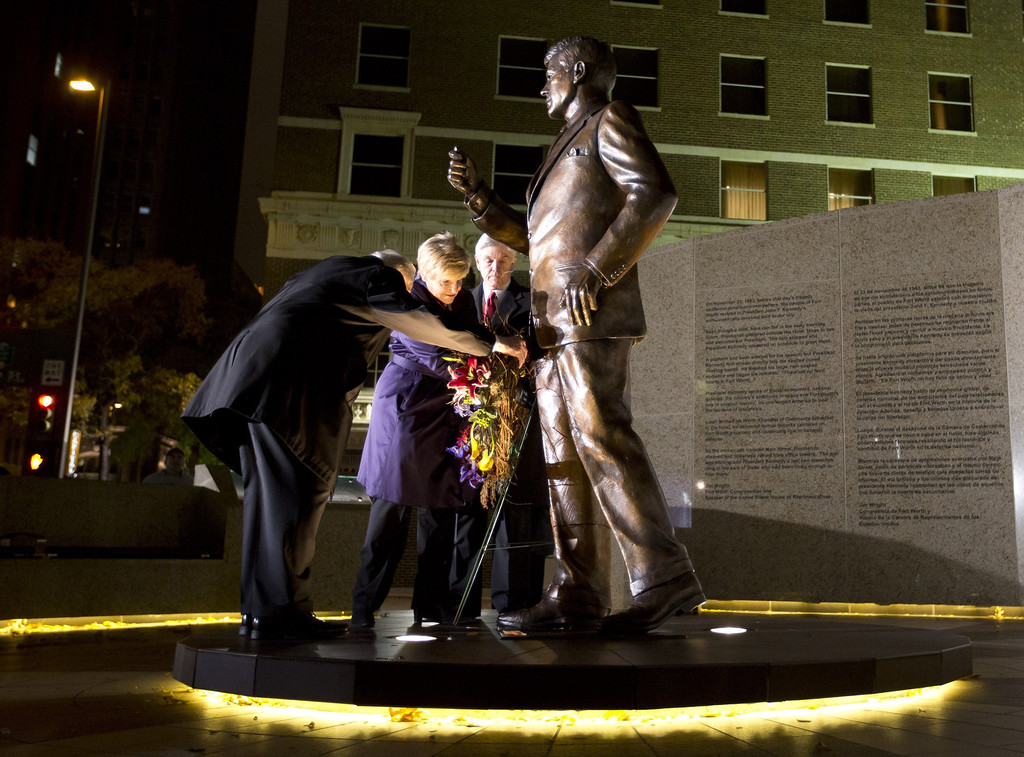 Description of . Clint Hill, who served on Jacqueline Kennedy's Secret Service detail, Fort Worth Mayor Betsy Price and Congressman Roger Williams place a wreath outside the Hilton hotel in Fort Worth, Texas, at a tribue to President John F. Kennedy on Friday, Nov. 22, 2013, marking the 50th anniversary of his death. (Joyce Marshall/Fort Worth Star-Telegram/MCT)