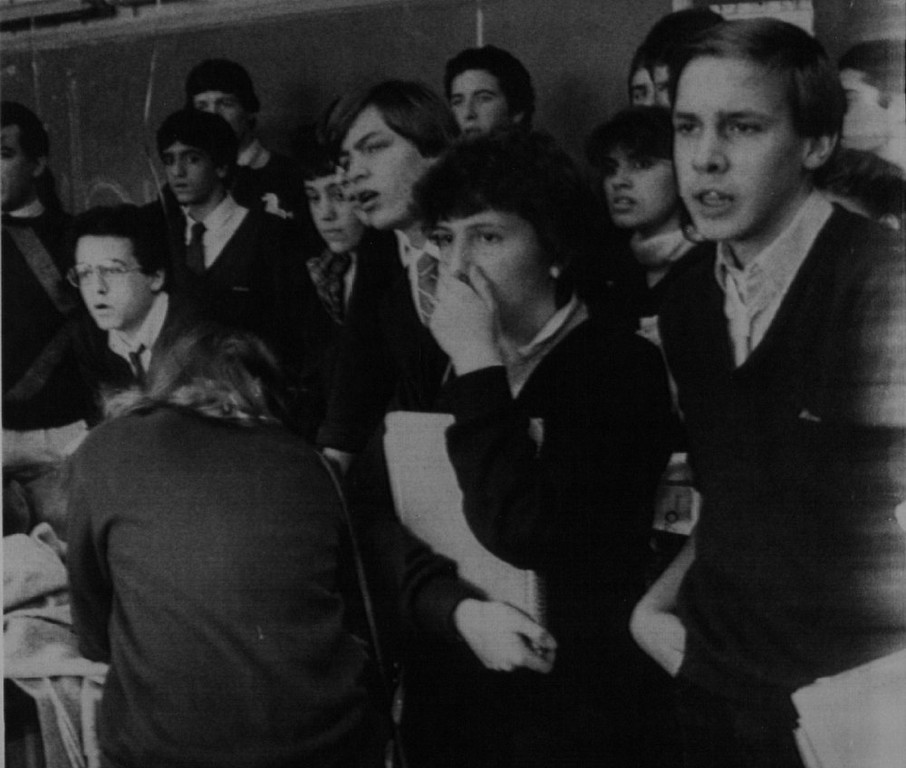 Description of . Students at Marian High School in Framingham, Mass., appear stunned as they watch a telecast of the explosion of the Space Shuttle Challenger Tuesday, Jan. 28, 1986. Space schoolteacher Christa McAuliffe, who died with the rest of the crew in the disaster, was a Framingham native and a 1966 graduate of the high school.  Denver Post Library Archive