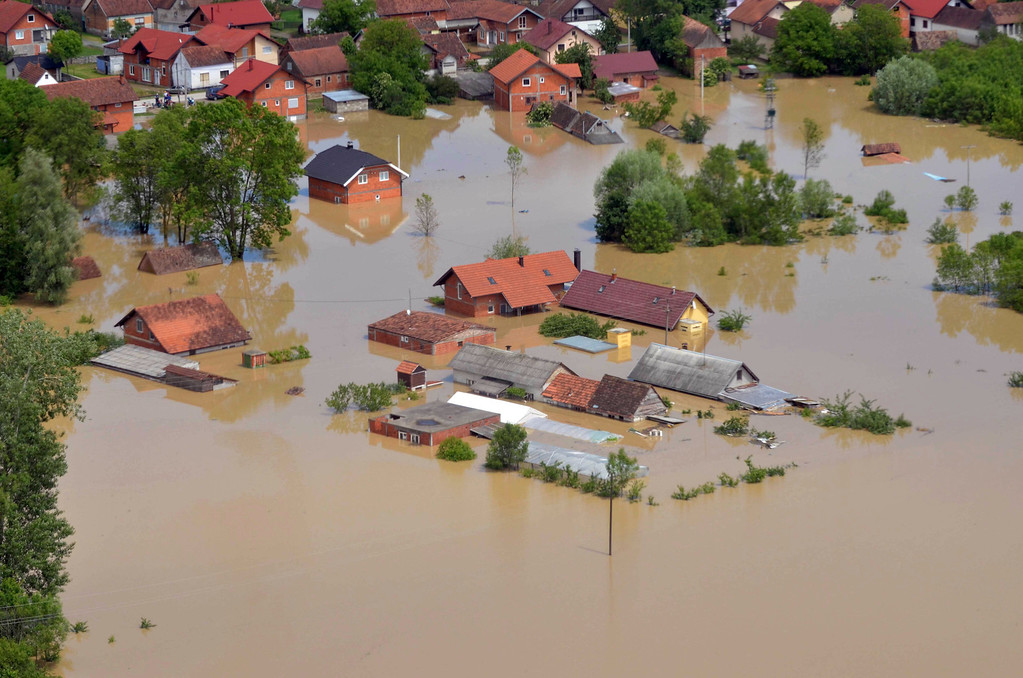 Description of . This image taken on taken Sunday, May 18, 2014 and made available by the Bosnia Army shows an aerial view of the flooded area near the Bosnian town of Brcko along the river Sava, 200 kms north of Bosnian capital of Sarajevo. Three months' worth of rain fell on the Balkan region in three days, producing the worst floods since rainfall measurements began 120 years ago. (AP Photo/Bosnia Army)