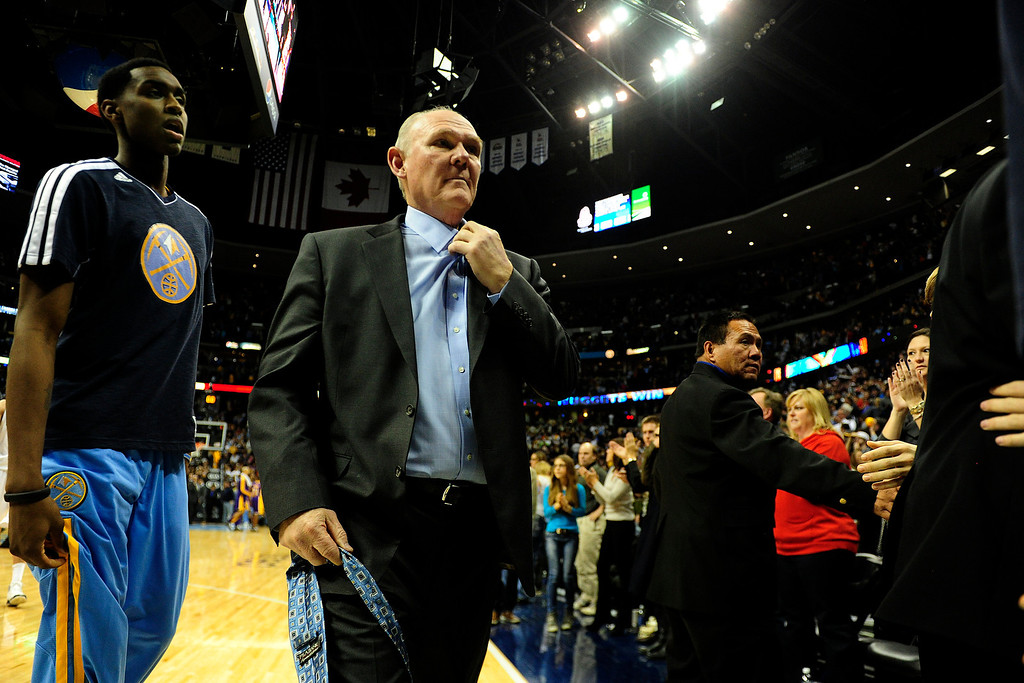 Description of . Denver Nuggets head coach George Karl unbuttons his shirt following the Nuggets' 126-114 win over the Los Angeles Lakers  at the Pepsi Center on Wednesday, December 26, 2012. AAron Ontiveroz, The Denver Post