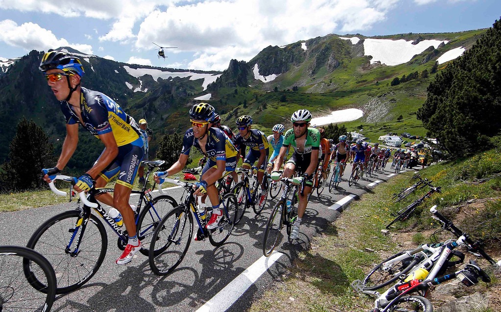 Description of . Team Saxo-Tinkoff rider Alberto Contador of Spain leads his team as they climb the Pailheres pass in the Pyrenees during the 195 km eight stage of the centenary Tour de France cycling race from Castres to Ax 3 Domaines July 6, 2013.     REUTERS/Eric Gaillard