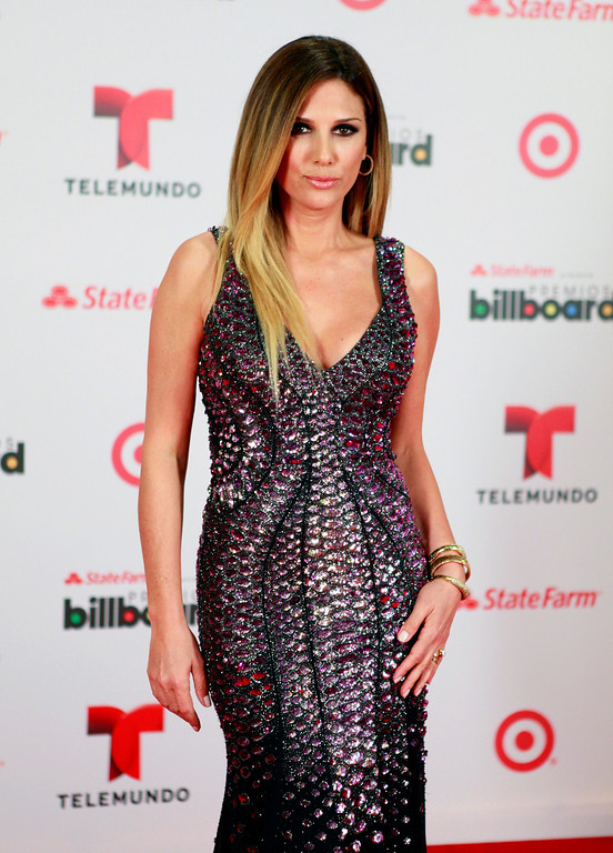 Description of . TV host Daisy Fuentes at the Latin Billboard Awards in Coral Gables, Fla. Thursday, April 25, 2013. (Photo by Carlo Allegri/Invision/AP)