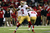 Quarterback Colin Kaepernick #7 of the San Francisco 49ers passes the ball in the second quarter against the Atlanta Falcons in the NFC Championship game at the Georgia Dome on January 20, 2013 in Atlanta, Georgia.  (Photo by Mike Ehrmann/Getty Images)