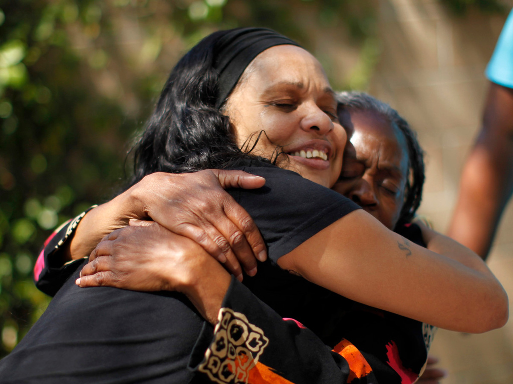 Description of . Barbara Dunlap, 61, (R) hugs Shannel Camel, 49, at Prototypes residential treatment program in Pomona, California, March 26, 2013. Prototypes is part of the Second Chance Women's Re-entry Court program, one of the first in the U.S. to focus on women. It offers a cost-saving alternative to prison for women who plead guilty to non-violent crimes and volunteer for treatment. Of the 297 women who have been through the court since 2007, 100 have graduated, and only 35 have been returned to state prison. Picture taken March 26, 2013. REUTERS/Lucy Nicholson