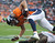DENVER - Denver Broncos tight end Jacob Tamme is upended after a short gain in the third quarter against Tampa Bay Sunday at Sports Authority Field. Steve Nehf, The Denver Post