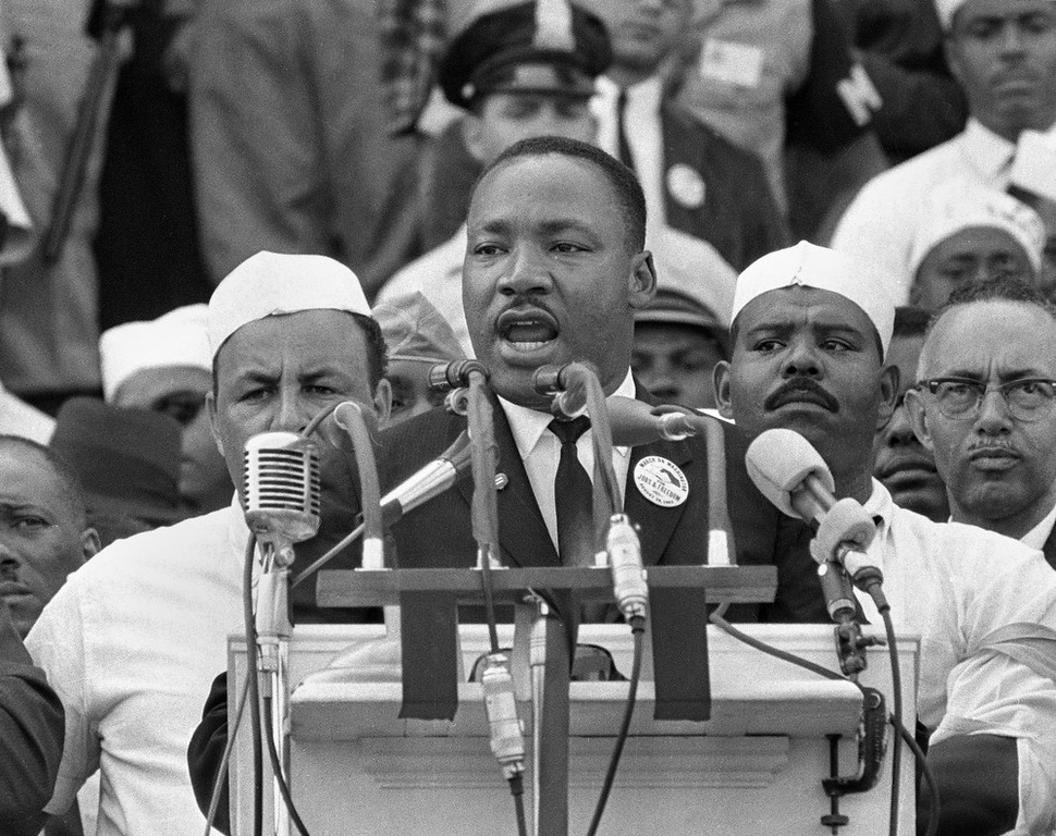 Description of . In this Aug. 28, 1963, black-and-white file photo Dr. Martin Luther King Jr., head of the Southern Christian Leadership Conference, addresses marchers during his