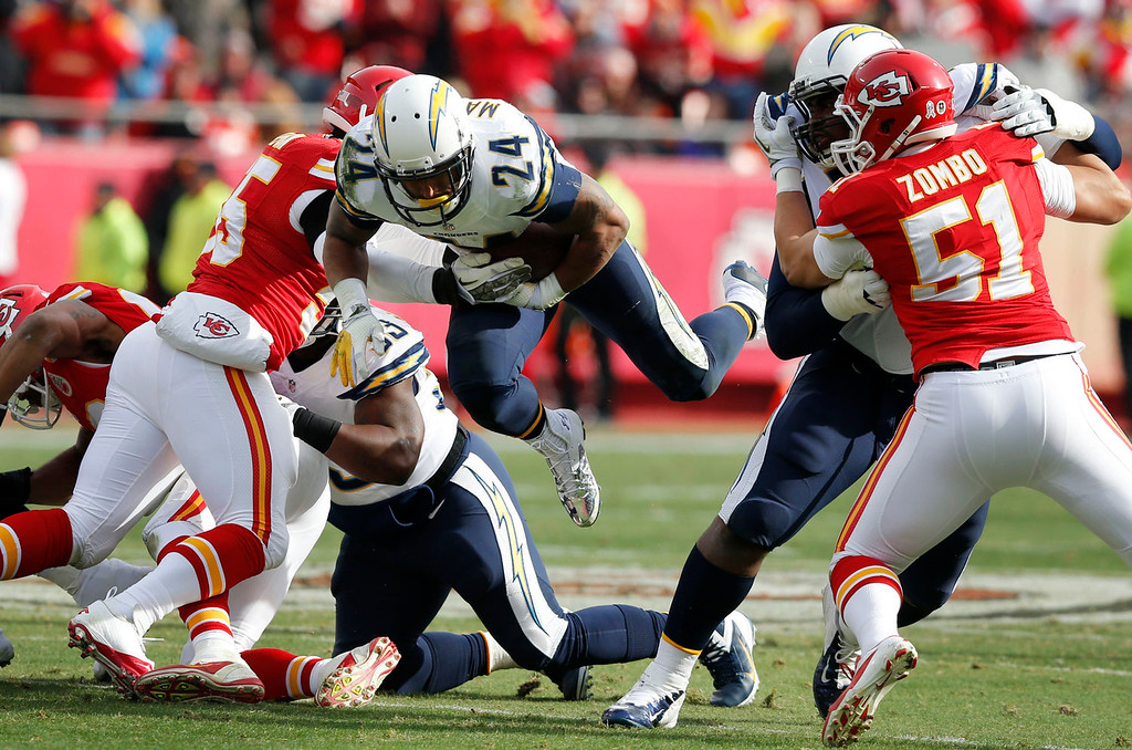 Description of . San Diego Chargers running back Ryan Mathews (24) dives for a first down between Kansas City Chiefs defenders during the first half of an NFL football game at Arrowhead Stadium in Kansas City, Mo., Sunday, Nov. 24, 2013. (AP Photo/Ed Zurga)