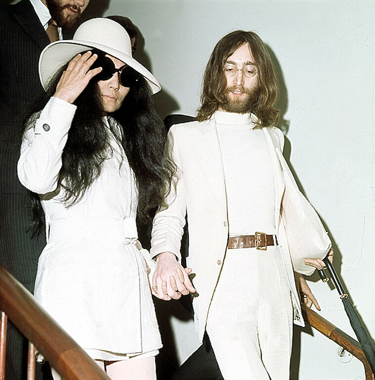 Description of . Beatle John Lennon, right, and Yoko Ono are shown circa 1969 at an unknown location.  (AP Photo)