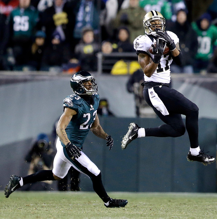 Description of . New Orleans Saints' Robert Meachem, right, catches a pass against Philadelphia Eagles' Patrick Chung during the second half of an NFL wild-card playoff football game, Saturday, Jan. 4, 2014, in Philadelphia. (AP Photo/Julio Cortez)