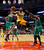 Denver Nuggets guard Wilson Chandler (21) shoots between Chicago Bulls center Joakim Noah, left, and forward Luol Deng during the second half of an NBA basketball game, Monday, March 18, 2013, in Chicago. Chandler led the Nuggets with 35 points in their 119-118 overtime win. (AP Photo/Charles Rex Arbogast)