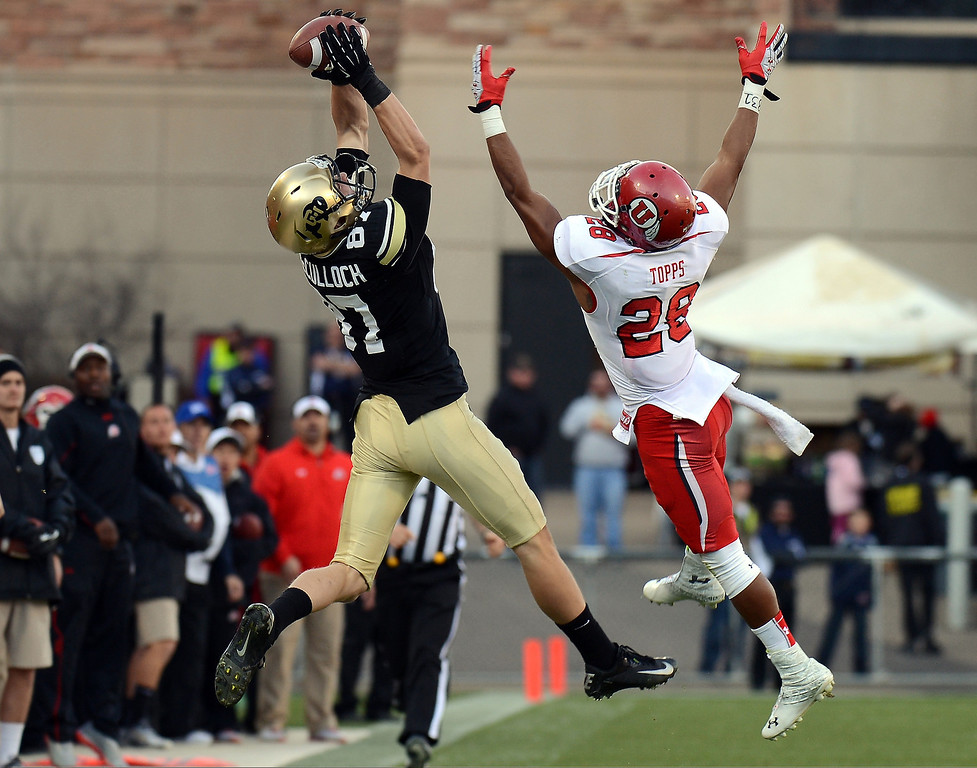 Description of . University of Colorado WR Tyler McCulloch, left, hauls in a pass over Utah's Reggie Topps in the second quarter of their game at Folsom Field in Boulder on November 23, 2012. Utah won 42-35. Hyoung Chang, The Denver Post