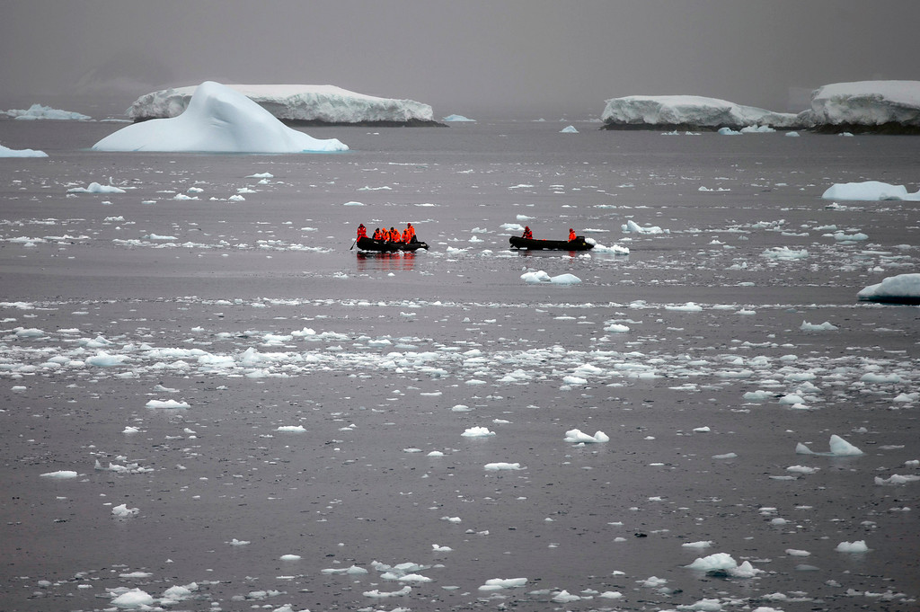 Description of . In this Jan. 22, 2015 photo, Chilean Navy officers transport scientists to Chile's Station Bernardo O'Higgins in Antarctica. Because there is no local industry, any pollution captured in the pristine ice and snow is from chemicals that traveled from afar, such as low levels of lead found in ice until it was phased out of gasoline, or radiation levels found from above-ground nuclear tests thousands of miles away and decades ago by the U.S. and the Soviet Union, according to David Vaughan, science director of the British Antarctic Survey. (AP Photo/Natacha Pisarenko)