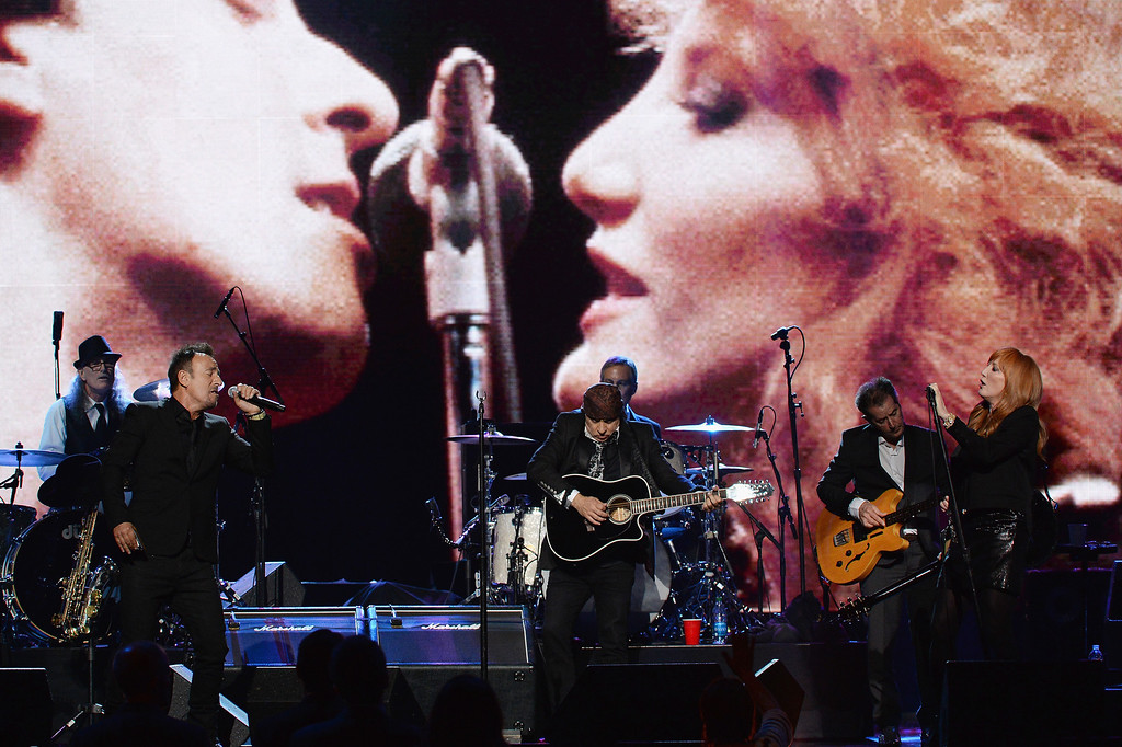 Description of . From left, Vini Lopez, Bruce Springsteen, Steve Van Zandt, Max Weinberg, Garry Tallent, and Patti Scialfa perform onstage at the 29th Annual Rock And Roll Hall Of Fame Induction Ceremony at Barclays Center of Brooklyn on April 10, 2014 in New York City.  (Photo by Larry Busacca/Getty Images)