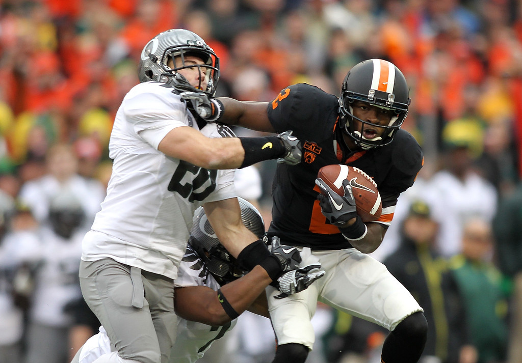 Description of . Markus Wheaton #2 of the Oregon State Beavers runs against Kenyon Parker #20 of the Oregon Ducks during the 114th Civil War on December 4, 2010 at the Reser Stadium in Corvallis, Oregon.  (Photo by Jonathan Ferrey/Getty Images)