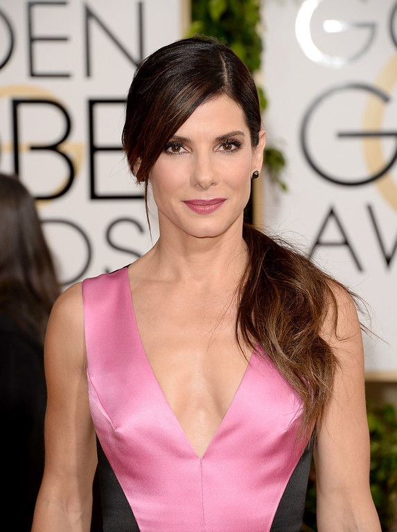 Description of . Actress Sandra Bullock attends the 71st Annual Golden Globe Awards held at The Beverly Hilton Hotel on January 12, 2014 in Beverly Hills, California.  (Photo by Jason Merritt/Getty Images)