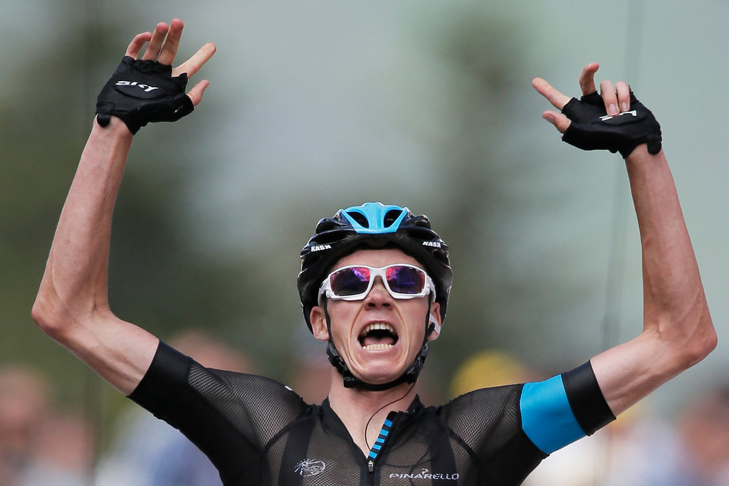 . New overall leader Christopher Froome of Britain crosses the finish line to win the eight stage of the Tour de France cycling race over 195 kilometers (122 miles) with start in Castres and finish in Ax 3 Domaines, Pyrenees region, France, Saturday July 6 2013. (AP Photo/Laurent Rebours)
