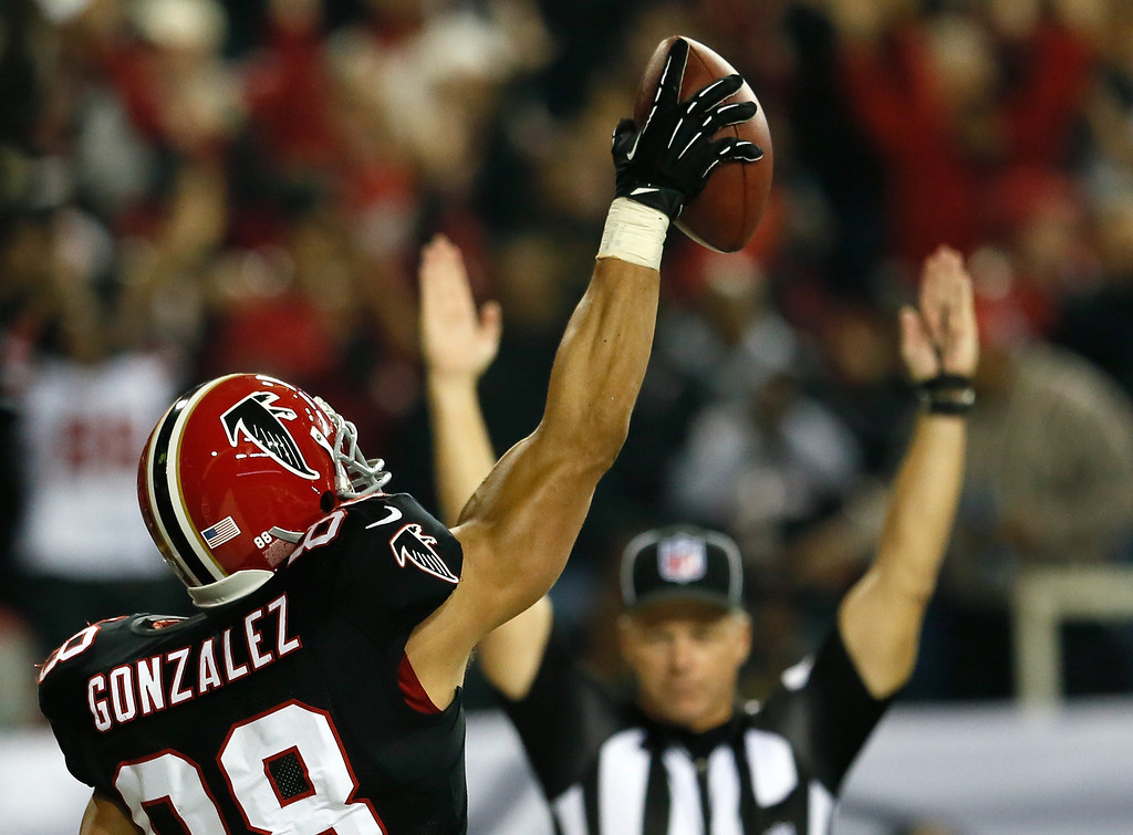 Description of . ATLANTA, GA - NOVEMBER 29:  Tony Gonzalez #88 of the Atlanta Falcons reacts after scoring a touchdown against the New Orleans Saints at Georgia Dome on November 29, 2012 in Atlanta, Georgia.  (Photo by Kevin C. Cox/Getty Images)