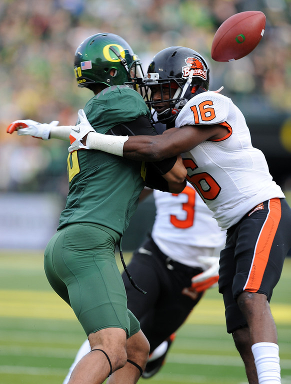 Description of . Cornerback Rashaad Reynolds #16 of the Oregon State Beavers breaks up a pass intended for wide receiver Lavasier Tuinei #80 of the Oregon Ducks in the first quarter of the game at Autzen Stadium on November 26, 2011 in Eugene, Oregon. (Photo by Steve Dykes/Getty Images)