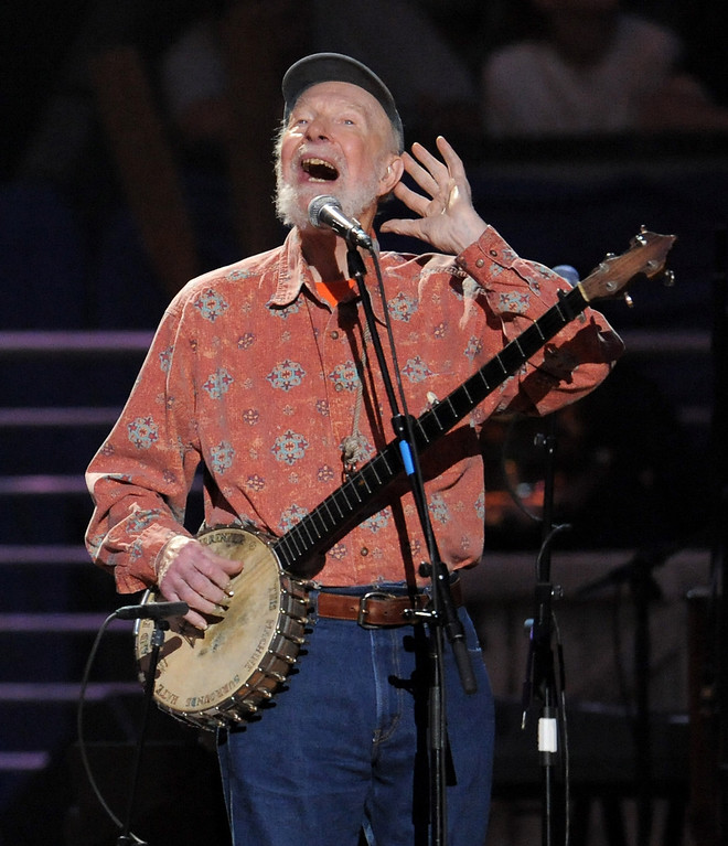 Description of . Pete Seeger performs at the benefit concert celebrating his 90th birthday at Madison Square Garden on Sunday, May 3, 2009 in New York. The concert is a benefit for Hudson River Sloop Clearwater, a sloop created by Pete Seeger to preserve and protect the Hudson River. (AP Photo/Evan Agostini)