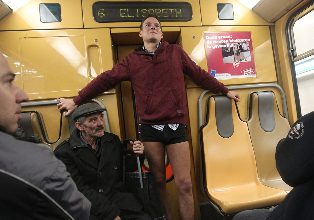 Description of . A man with no pants takes part in the 'No Pants Metro Ride' in Brussels, Sunday, Jan. 12, 2014. The idea started years ago as a small prank in New York and has grown into an international celebration of silliness, with dozens of cities around the world participating each year. (AP Photo/Yves Logghe)