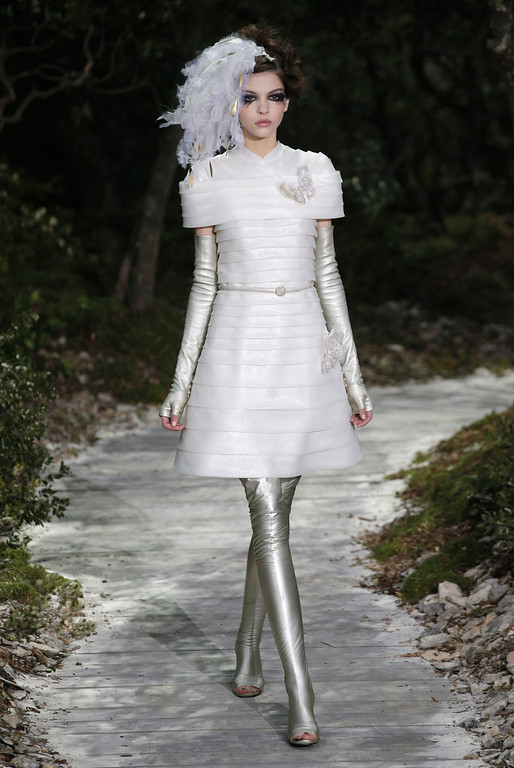 Description of . A model presents a creation by German fashion designer Karl Lagerfeld for Chanel's Spring-Summer 2013 Haute Couture fashion collection, presented in Paris, Tuesday, Jan.22, 2013. (AP Photo/Christophe Ena)