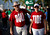Alabama Crimson Tide fans wear Roll Tide shirts outside Sun Life stadium before the BCS National Championship college football game between Alabama and the Notre Dame Fighting Irish in Miami, Florida January 7, 2013. REUTERS/Mike Segar