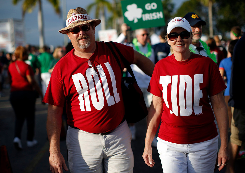 Description of . Alabama Crimson Tide fans wear Roll Tide shirts outside Sun Life stadium before the BCS National Championship college football game between Alabama and the Notre Dame Fighting Irish in Miami, Florida January 7, 2013. REUTERS/Mike Segar