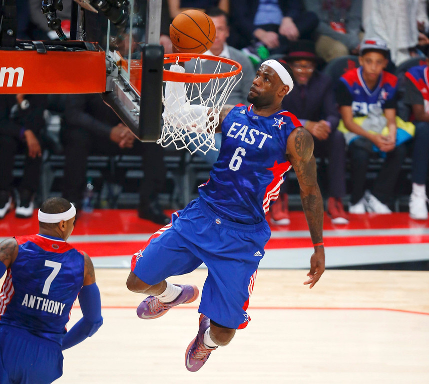 Description of . NBA All-Star LeBron James of the Miami Heat (6) slam dunks off a pass by teammate Carmelo Anthony of the New York Knicks (7) during the 2013 NBA All-Star basketball game in Houston, Texas, February 17, 2013. REUTERS/Jeff Haynes