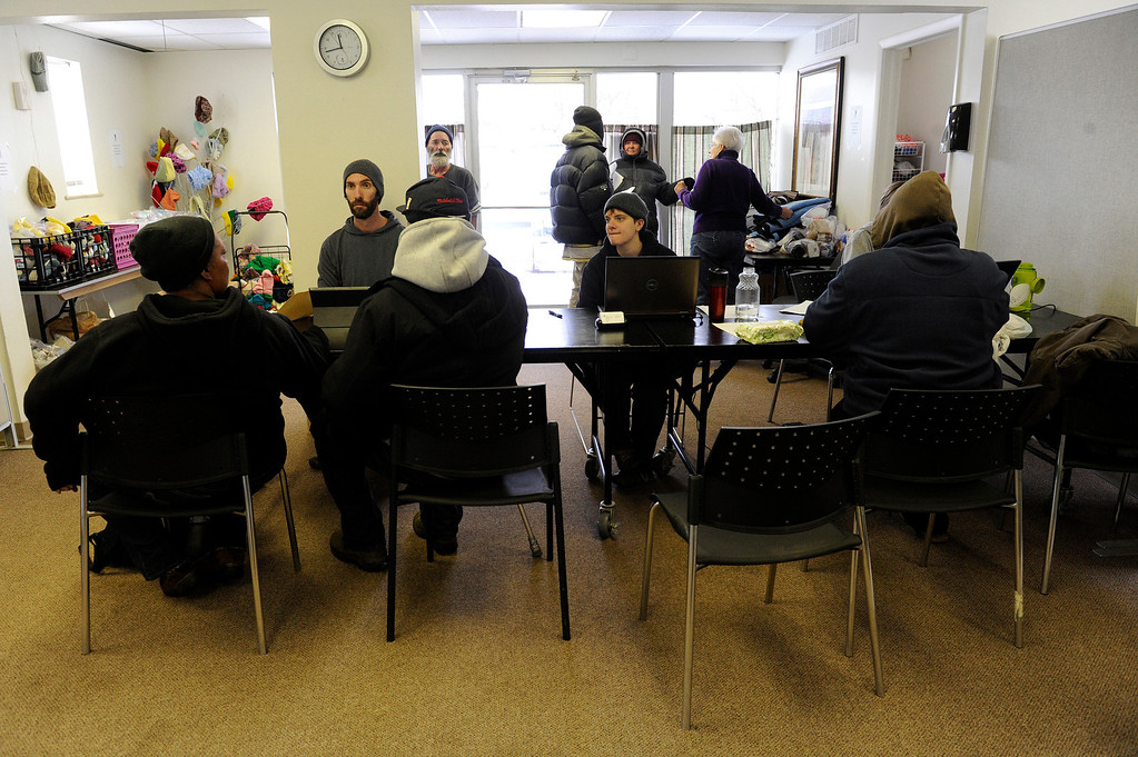 Description of . AURORA, CO - NOVEMBER 21: Volunteers collect personal information from homeless clients during an Aurora Warms the Night Cold Weather Shelter Program on November 21, 2013, in Aurora, Colorado. AWTN provides assistance to the homeless with a number of initiatives, including the Cold Weather Shelter Program which gives clients motel vouchers, food, clothing and hygiene kits on nights expected to be 20 degrees or colder. (Photo by Anya Semenoff/YourHub)
