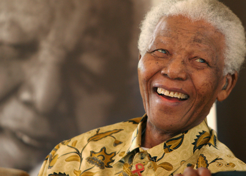 Description of . In this Dec. 7, 2005 file photo, former South African President Nelson Mandela, 87, smiles the Mandela Foundation in Johannesburg. On Thursday, Dec. 5, 2013, Mandela died at the age of 95. (AP Photo/Denis Farrell, File)