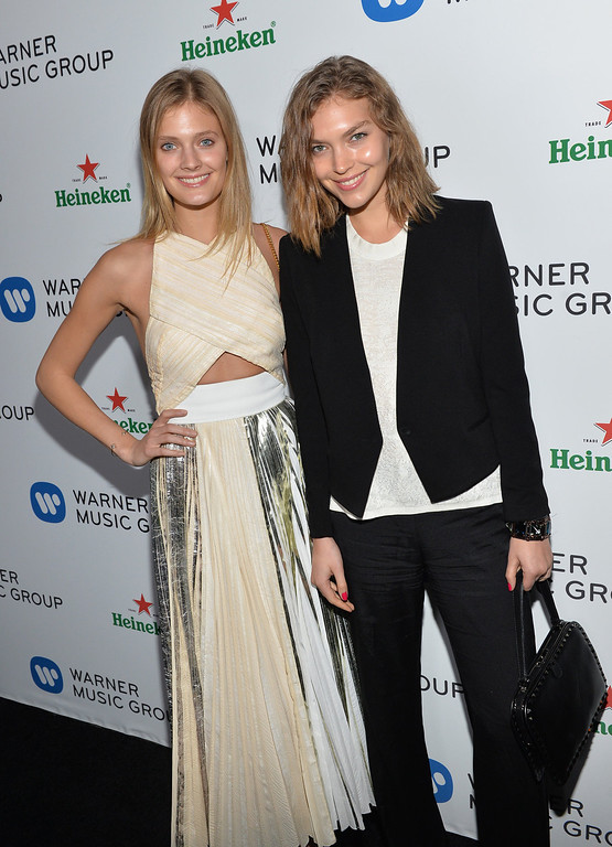Description of . Models Constance Jablonski (L) and Arizona Muse attend the Warner Music Group annual GRAMMY celebration on January 26, 2014 in Los Angeles, California.  (Photo by Michael Buckner/Getty Images for Warner Bros.)