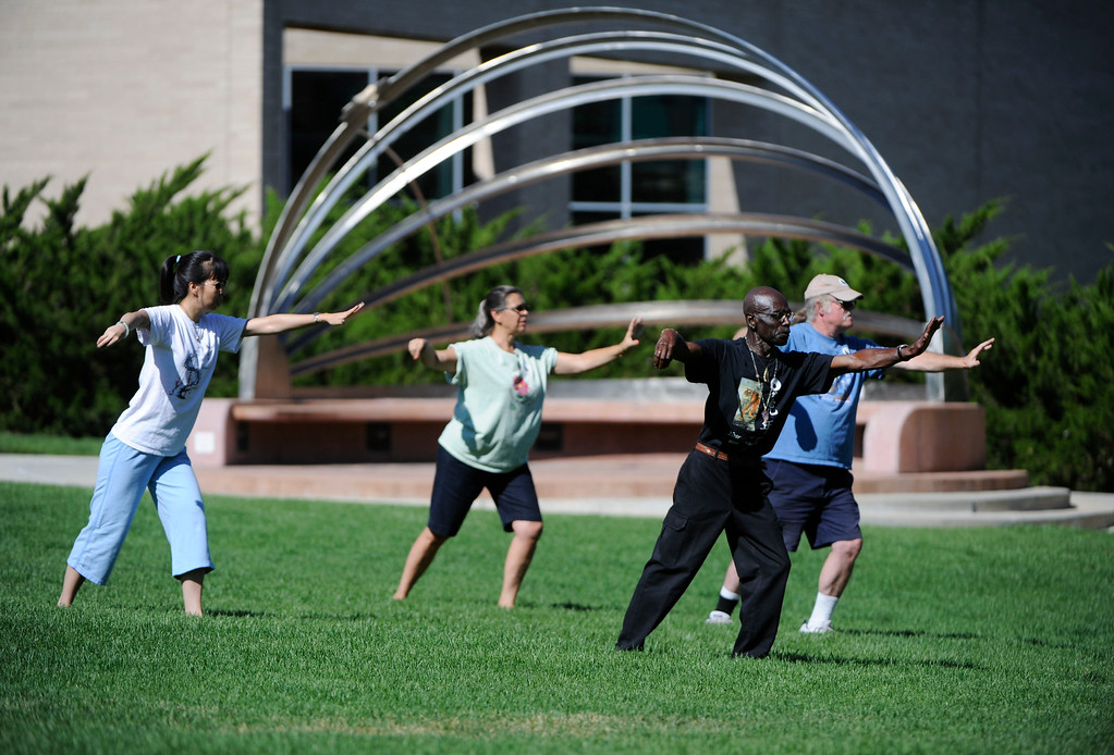 "Description of . AURORA, CO - JULY 20:  Tai Chi was offered as a ""healing activity"" at the 7/20 Day of Remembrance 2013 at the Aurora Municipal Center Saturday morning, July 20, 2013. Over 200 people attended the service in honor of the 12 people killed and over 60 people injured in last years Aurora theater shooting. The memorial service, marking the one-year anniversary of the tragic shooting,  included prayer, songs and speeches from local officials and the Governor of Colorado, John Hickenlooper. (Photo By Andy Cross/The Denver Post)"