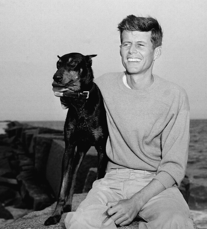 Description of . Kennedy relaxes with his dog, Mo, on June 22, 1946 at  Hyannisport, Mass. Peter J. Carroll, Associated Press file